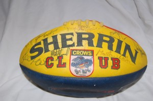 An official Sherrin Football autographed by AFL Adelaide Crows