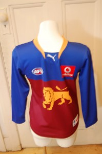 Proud to wear their Lions themed Football Jumper
