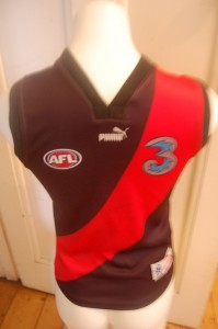 Young fan would love this signed retro Bombers Jumper