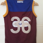 Brisbane Lions Jumper with hand made and hand sewn on favourite players number